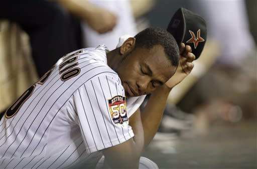 Houston Astros relief pitcher Enerio Del Rosario sits on the bench after being pulled during the eighth inning of a baseball game against the Philadelphia Phillies on Friday, Sept. 14, 2012, in Houston. (AP Photo/David J. Phillip)