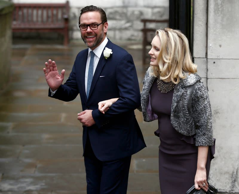 FILE PHOTO: James Murdoch, the son of media mogul Rupert Murdoch, and his wife Kathryn Hufschmid arrive at St Bride's church for a service to celebrate the wedding between Rupert Murdoch and former supermodel Jerry Hall which took place on Friday, in London
