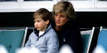 <p>Prince William sitting on Princess Diana's lap while watching a polo match. </p>