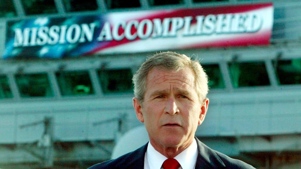 George W Bush declares combat in Iraq over aboard aircraft carrier USS Abraham Lincoln in 2003 (REUTERS/Larry Downing)