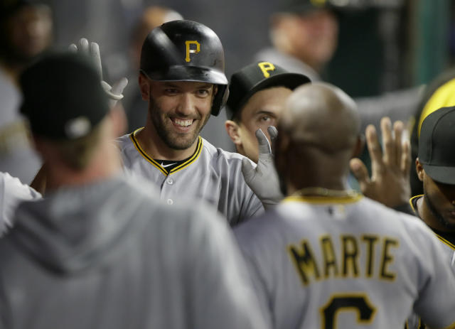 Pittsburgh Pirates catcher Jacob Stallings, second from left, gets congratulations from teammates after hitting a solo home run during the fifth inning of a baseball game against the Los Angeles Angels in Anaheim, Calif., Monday, Aug. 12, 2019. (AP Photo/Alex Gallardo)