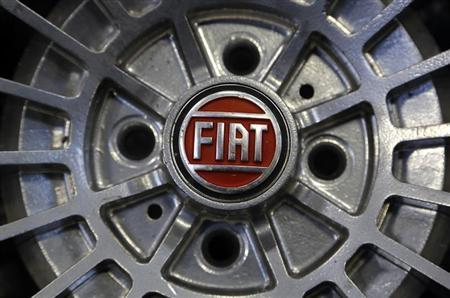 Fiat logo is seen on the wheel of a Fiat car in Turin