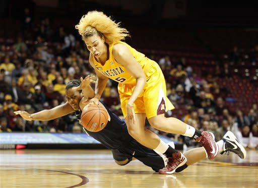 Penn State forward Talia East (5) fights for the ball against Minnesota forward Micaella Riche in the first half of an NCAA college basketball game on Thursday, Feb. 28, 2013, in Minneapolis. (AP Photo/Stacy Bengs)