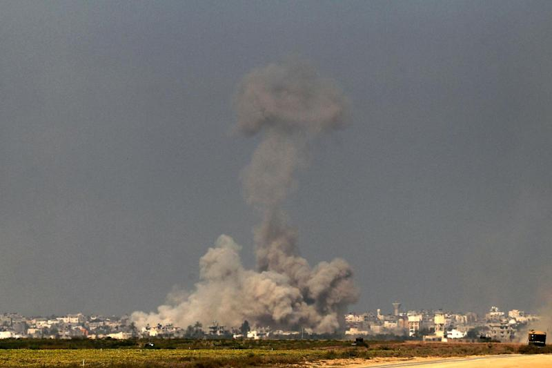 In a picture taken from the Israel-Gaza border, smoke rises from the coastal side of the Gaza Strip following an Israeli controlled explosion of a tunnel, on August 1, 2014