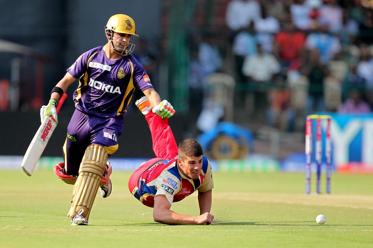 Moises Henriques attempts to field the ball during match 12 of the Pepsi Indian Premier League between The Royal Challengers Bangalore and The Kolkata Knight Riders  held at the M. Chinnaswamy Stadium, Bengaluru  on the 11th April 2013Photo by Prashant Bhoot-IPL-SPORTZPICS Use of this image is subject to the terms and conditions as outlined by the BCCI. These terms can be found by following this link:https://ec.yimg.com/ec?url=http%3a%2f%2fwww.sportzpics.co.za%2fimage%2fI0000SoRagM2cIEc&t=1498196059&sig=VQ6UV9XZR77ZW3RL7RW3qA--~C