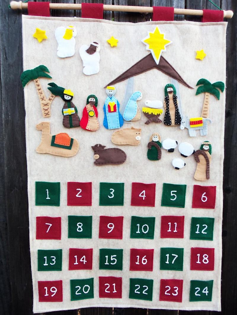 """This undated publicity photo provided by Jessica Anderson shows a carefully cut out and sewed nativity scene that tells the story of Jesus'  birth which Anderson, of Rancho Cordova, Calif., made to teach her three young children. She's convinced advent calendars promote family bonding. """"I feel with the advent calendar, it's something they will remember when they grow up,"""" says Anderson, who blogs at Cutesy Crafts. (AP Photo/Jessica Anderson, Jessica Anderson)"""