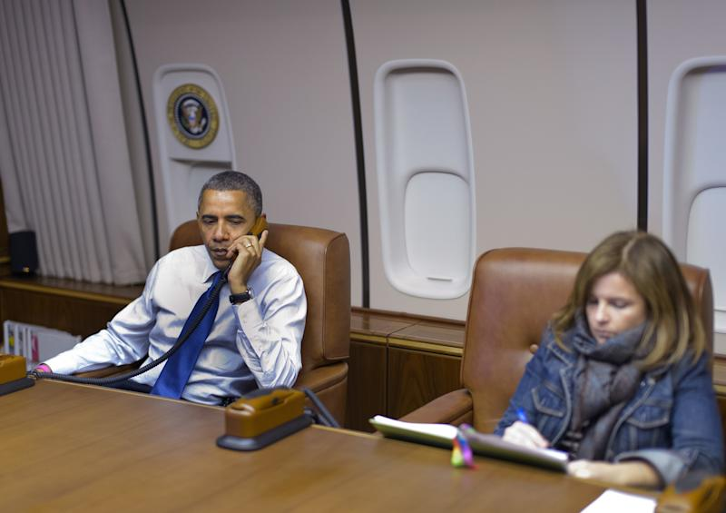 The author and President Obama en route from Denver to Los Angeles aboard Air Force One in October 2012. (MANDEL NGAN via Getty Images)