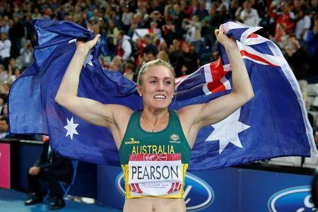 FILE PHOTO: Sally Pearson of Australia celebrates after winning the gold medal in the women's 100m hurdles at the 2014 Commonwealth Games in Glasgow, Scotland, August 1, 2014. REUTERS/Suzanne Plunkett/File Photo