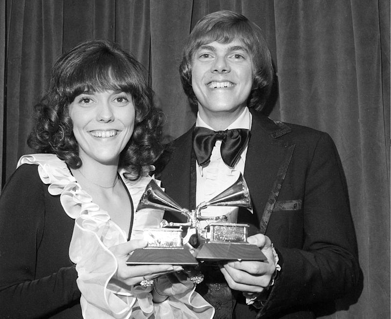 """FILE - This March 14, 1972 file photo shows Karen Carpenter, left, and Richard Carpenter, of The Carpenters, posing with their award for best pop vocal per during the 14th annual 1971 Grammy Awards in New York. Richard Carpenter sued Universal Music Group on Wednesday, Jan. 11, 2017, seeking more than $2 million in royalties he says are owed to him and the estate of his late sister for sales of digital music on services such as Apple's iTunes. The Carpenters won three Grammy Awards, including for  their song """"Close to You."""" (AP Photo/File)"""