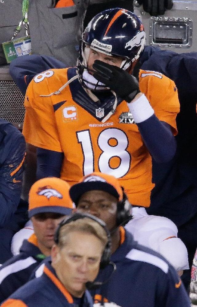 Denver Broncos' Peyton Manning watches play against the Seattle Seahawks during the second half of the NFL Super Bowl XLVIII football game Sunday, Feb. 2, 2014, in East Rutherford, N.J. (AP Photo/Charlie Riedel)