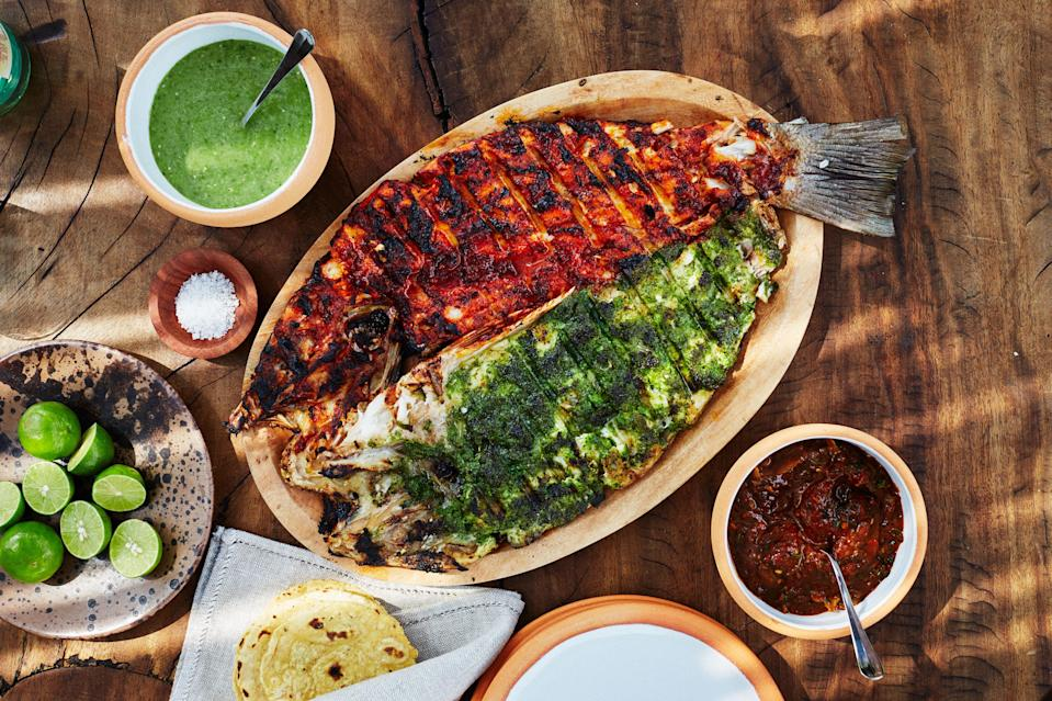 "We modified Contramar's whole-fish method with individual fillets, which are easier to handle—but the flavor is the same! <a href=""https://www.bonappetit.com/recipe/contramars-red-and-green-grilled-snapper?mbid=synd_yahoo_rss"" rel=""nofollow noopener"" target=""_blank"" data-ylk=""slk:See recipe."" class=""link rapid-noclick-resp"">See recipe.</a>"