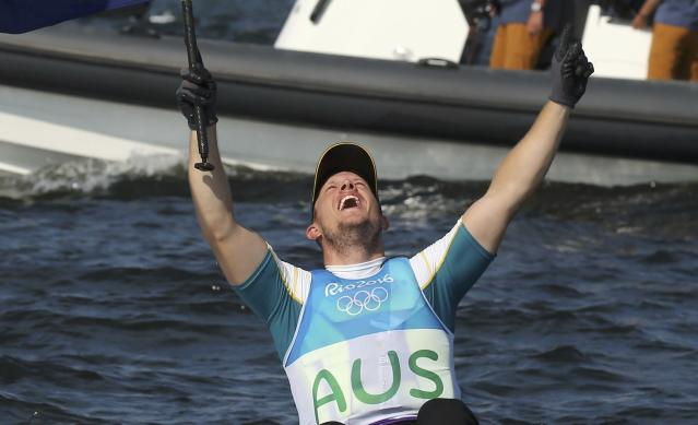 2016 Rio Olympics - Sailing - Preliminary - Men's One Person Dinghy - Laser - Medal Race - Marina de Gloria - Rio de Janeiro, Brazil - 16/08/2016. Tom Burton (AUS) of Australia celebrates winning gold medal. REUTERS/Benoit Tessier FOR EDITORIAL USE ONLY. NOT FOR SALE FOR MARKETING OR ADVERTISING CAMPAIGNS. TPX IMAGES OF THE DAY