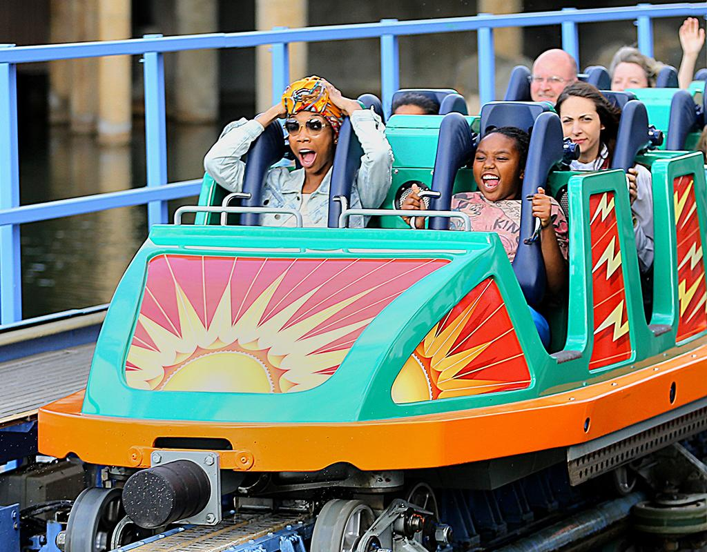 Singer Brandy Norwood and her daughter Sy'rai stuck their tongues out as they rode the California Screamin' roller-coaster at Disneyland's California Adventure park. The mother and daughter duo got the VIP experience as they enjoyed the day getting on a bunch of rides and acting silly with their tour guide. Brandy wore an African head wrap whilst her daughter wore Mickey Mouse ears. Pictured: Brandy Norwood and Sy'rai Norwood Ref: SPL519353  020413  Picture by: Sharpshooter Images/Splash   Splash News and Pictures Los Angeles:310-821-2666 New York:212-619-2666 London:870-934-2666 photodesk@splashnews.com