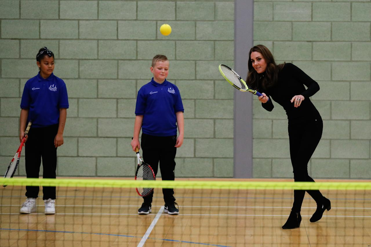 <p></p><p><span>While on a royal visit to Coach Core Essex, Middleton and Prince William met with students to talk about sports — but it was when the Duchess took to the courts in her heeled, black booties that she gained some serious respect. <em>(Photo via Getty Images)</em></span> </p><p></p>