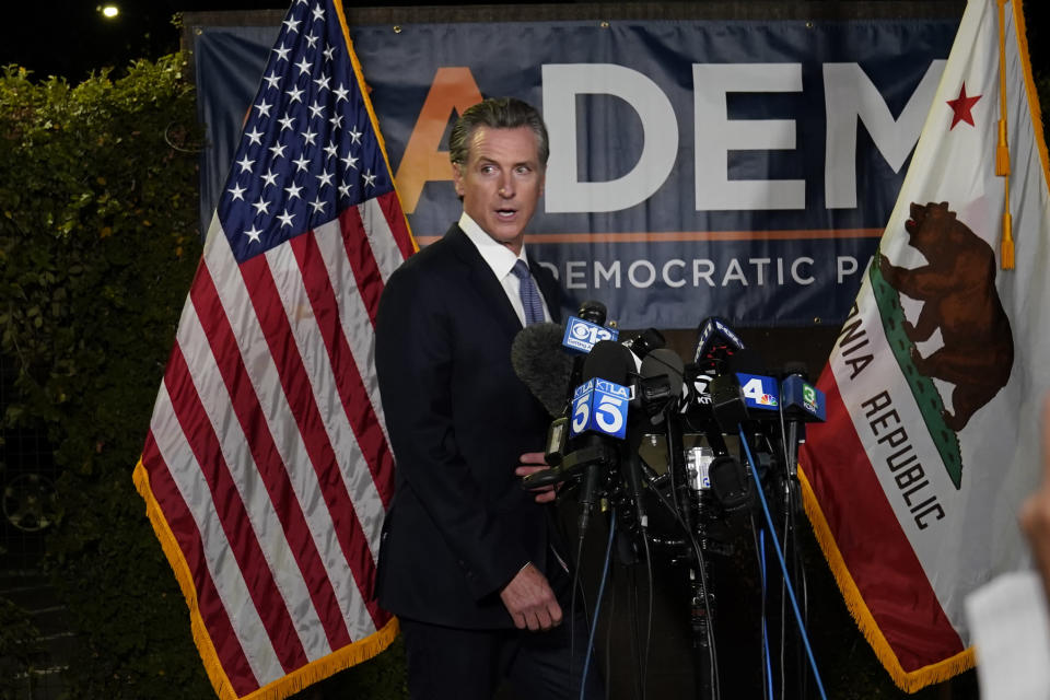 California Gov. Gavin Newsom walks to the podium to talk with reporters, after beating back the recall attempt that aimed to remove him from office, at the John L. Burton California Democratic Party headquarters in Sacramento, Calif., Tuesday, Sept. 14, 2021. (AP Photo/Rich Pedroncelli)