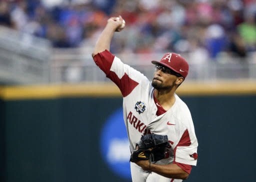 Arkansas pitcher Isaiah Campbell works against Florida in the fifth inning of an NCAA College World Series baseball game in Omaha, Neb., Friday, June 22, 2018. (AP Photo/Nati Harnik)