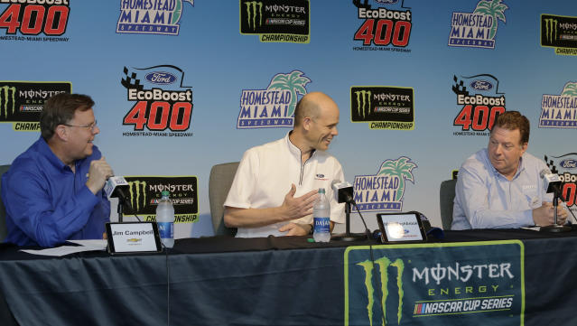 Manufacturers representatives, from left , Jim Campbell for Chevrolet, Mark Rushbrook for Ford, and Ed Laukes for Toyota, talk to the media during a press conference before practice for a NASCAR Cup Series auto race on Saturday, Nov. 16, 2019, at Homestead-Miami Speedway in Homestead, Fla. (AP Photo/Terry Renna)