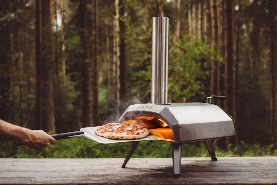 """<p>This powerful and portable wood and charcoal-fired pizza oven, heats up to temperatures of 500°C in 15 minutes so you can cook delicious, Neapolitan-style pizzas in just 60 seconds.</p><p><a class=""""link rapid-noclick-resp"""" href=""""https://go.redirectingat.com?id=127X1599956&url=https%3A%2F%2Fwww.lakeland.co.uk%2F62647%2FOoni-Karu-12-Multi-Fuel-Pizza-Oven&sref=https%3A%2F%2Fwww.goodhousekeeping.com%2Fuk%2Fhouse-and-home%2Fgardening-advice%2Fg32401016%2Fbest-garden-products%2F"""" rel=""""nofollow noopener"""" target=""""_blank"""" data-ylk=""""slk:BUY NOW"""">BUY NOW</a> <strong>£299</strong></p>"""