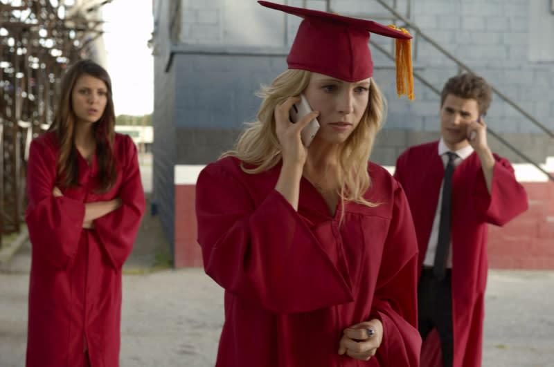 """Graduation"" -- Nina Dobrev as Elena, Candice Accola as Caroline, and Paul Wesley as Stefan"