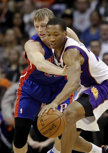 Phoenix Suns' Wesley Johnson, right, tries to keep the ball away from Detroit Pistons' Kyle Singler in the first half of an NBA basketball game on Friday, Nov. 2, 2012, in Phoenix.(AP Photo/Ross D. Franklin)