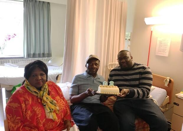 Gary Clarke, right, with his father Vincent Clarke and mother Esme Clarke at their long-term care home in Scarborough. (Submitted by Gary Clarke - image credit)