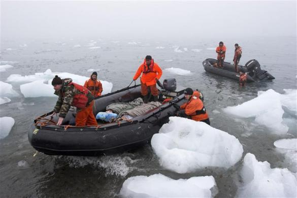 A passenger is evacuated after a chunk of an Arctic glacier broke into the sea and triggered a huge wave that injured 18 people on board the cruise vessel Alexey Maryshev August 9, 2007.