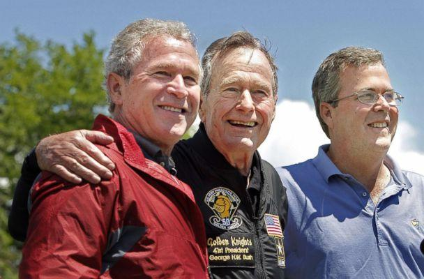 PHOTO: Former President George H. W. Bush poses with his sons, former President George W. Bush and Jeb Bush after completing a parachute jump in Kennebunkport, June 12, 2009 for his 85th birthday. (Gregory Rec/Portland Press Herald via Getty Images, file)