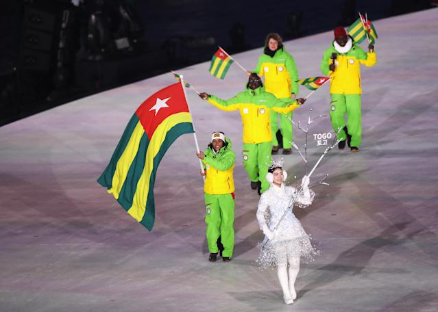 <p>Flag bearer Mathilde-Amivi Petitjean of Togo leads the team during the Opening Ceremony of the PyeongChang 2018 Winter Olympic Games at PyeongChang Olympic Stadium on February 9, 2018 in Pyeongchang-gun, South Korea. (Photo by Ronald Martinez/Getty Images) </p>