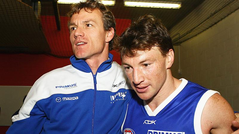 Dean Laidley and Brent Harvey, pictured here after a North Melbourne game in 2006.