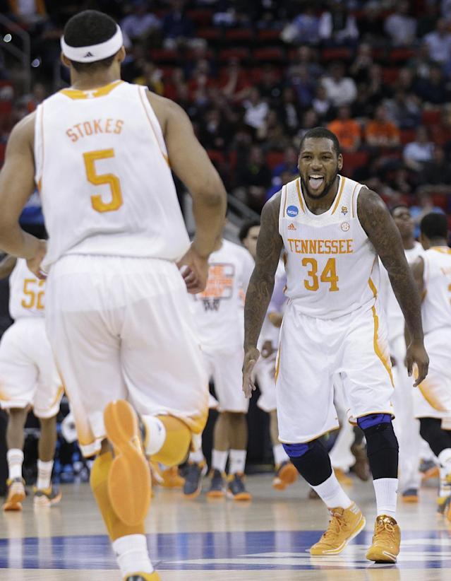 Tennessee forward Jeronne Maymon (34) reacts to Tennessee forward Jarnell Stokes (5) dunk against Mercer during the second half of an NCAA college basketball third-round tournament game, Sunday, March 23, 2014, in Raleigh. (AP Photo/Chuck Burton)