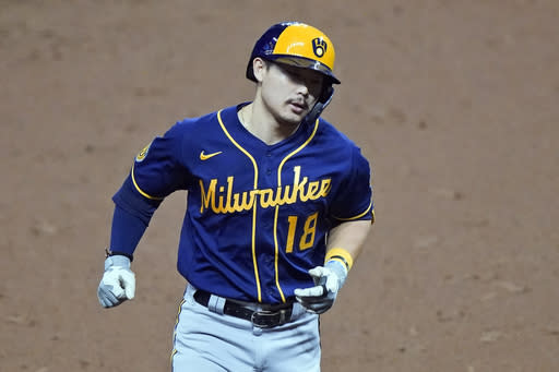 Milwaukee Brewers' Keston Hiura runs the bases after hitting a two-run home run in the eighth inning in a baseball game against the Cleveland Indians, Friday, Sept. 4, 2020, in Cleveland. (AP Photo/Tony Dejak)