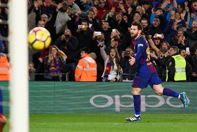 Barcelona forward Lionel Messi celebrates a goal during the Spanish league football match between FC Barcelona and Deportivo Alaves at the Camp Nou stadium in Barcelona on January 28, 2018