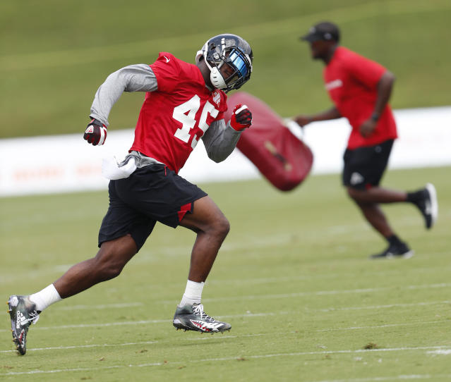 FILE - In this June 13, 2018 file photo Atlanta Falcons linebacker Deion Jones (45) runs during NFL football minicamp in Flowery Branch, Ga. The Falcons have placed Jones on injured reserve, taking a second 2017 Pro Bowler from the defense in less than a week. Jones hurt his foot in the team's 18-12 opening loss at Philadelphia. In a statement released by the team, Falcons coach Dan Quinn said Monday, Sept. 10, 2018 that Jones will require surgery but is expected to return this season. (AP Photo/John Bazemore, file)