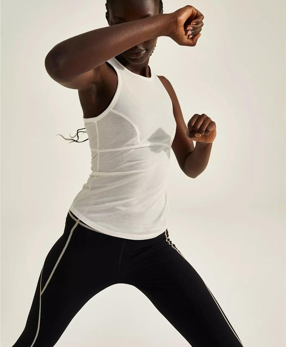 <p>You can't go wrong with this white <span>Halle Berry x Sweaty Betty Frankie Racer Neck Tank</span> ($64).</p>