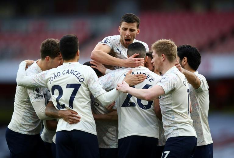 Group hug: Manchester City stretched their winning run at Arsenal to 18 games