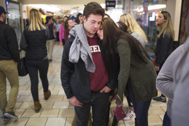 SOUTH PORTLAND, ME – NOVEMBER 25 2016: Max Richardson, 17, of Cumberland, and Trinity Turcotte, 16, of Brunswick, wait in line to get into the store Victoria's Secret's Pink store just after midnight during Black Friday at the Maine Mall. (Brianna Soukup/Getty Images)