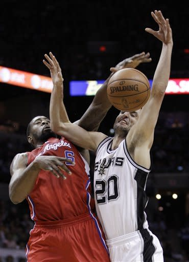 REMOVES FIRST-ROUND FROM DESCRIPTION - San Antonio Spurs' Manu Ginobili, right, of Argentina, is blocked by Los Angeles Clippers' DeAndre Jordan during the second quarter of Game 1 of an NBA basketball Western Conference semifinal playoff series, Tuesday, May 15, 2012, in San Antonio. (AP Photo/Eric Gay)