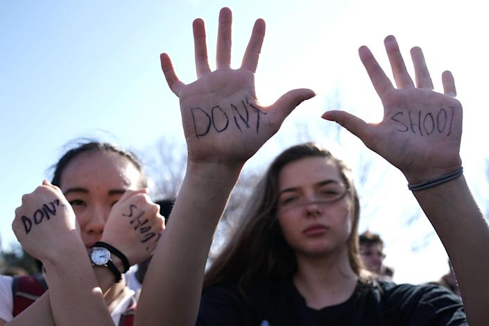 <p>Students participate in a protest against gun violence February 21, 2018 on Capitol Hill in Washington, DC. Hundreds of students from a number of Maryland and DC schools walked out of their classrooms and made a trip to the U.S. Capitol and the White House to call for gun legislation, one week after 17 were killed in the latest mass school shooting at Marjory Stoneman Douglas High School in Parkland, Fla. (Photo: Alex Wong/Getty Images) </p>