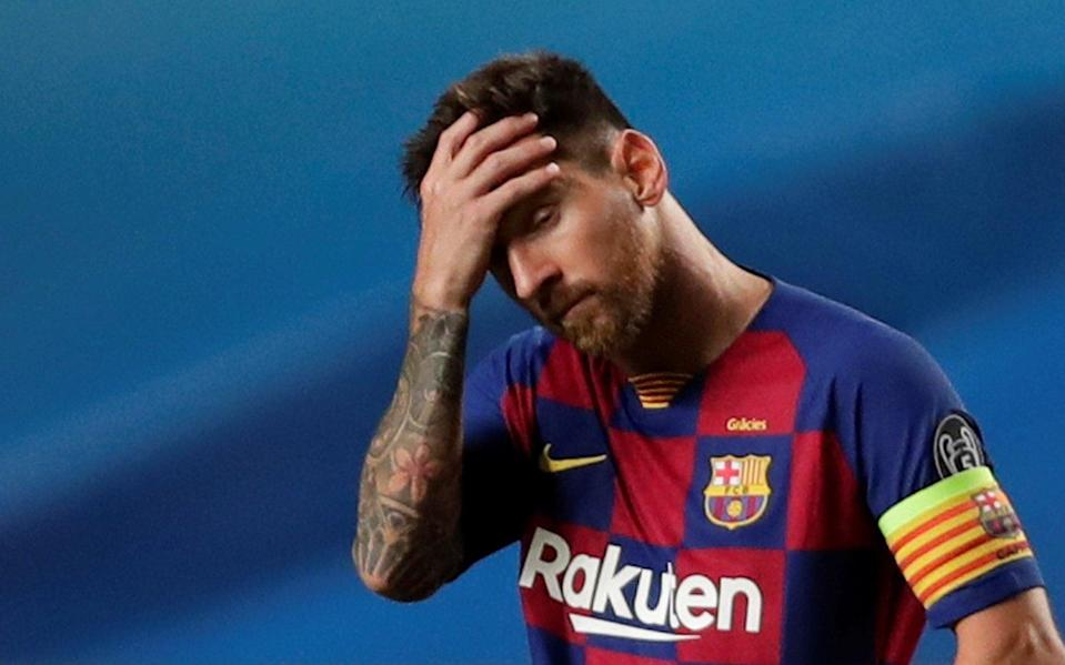 Barcelona's Lionel Messi looks dejected, as play resumes behind closed doors - Reuters