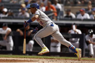 New York Mets' Francisco Lindor starts to run after hitting an RBI-single during the fourth inning of the first baseball game of a doubleheader against the New York Yankees on Sunday, July 4, 2021, in New York. (AP Photo/Adam Hunger)