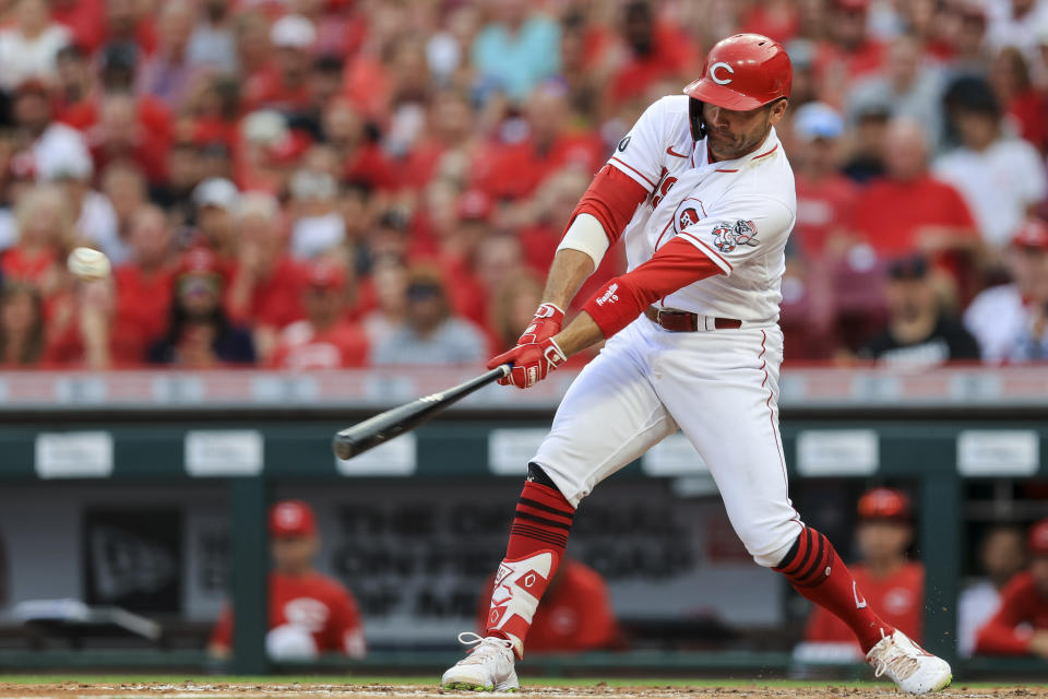Cincinnati Reds' Joey Votto hits an RBI-single during the third inning of a baseball game against the Atlanta Braves in Cincinnati, Thursday, June 24, 2021. (AP Photo/Aaron Doster)
