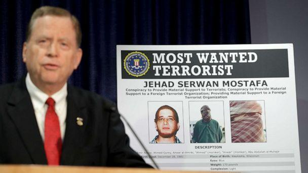 PHOTO: U.S Attorney Robert Brewer speaks in front of an FBI poster depicting Jehad Serwan Mostafa during a news conference Monday, Dec. 2, 2019, in San Diego. (Gregory Bull/AP)