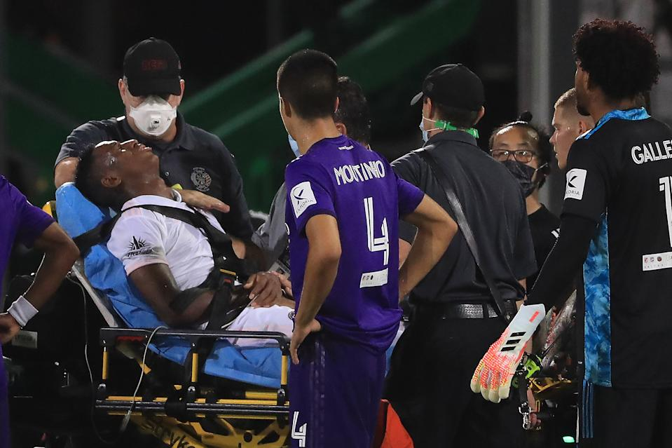 REUNION, FLORIDA - JULY 08: Andres Reyes #3 of Inter Miami is carried off the field after receiving a foul during a match between Orlando City and Inter Miami as part of MLS is back Tournament at ESPN Wide World of Sports Complex on July 08, 2020 in Reunion, Florida. (Photo by Mike Ehrmann/Getty Images)