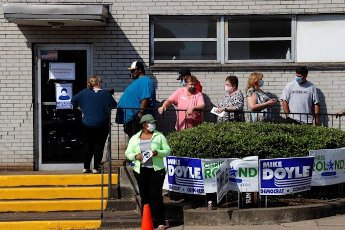 Voters wait in line to vote in the Pennsylvania primary outside the North Braddock Municipal Building on June 2, 2020.