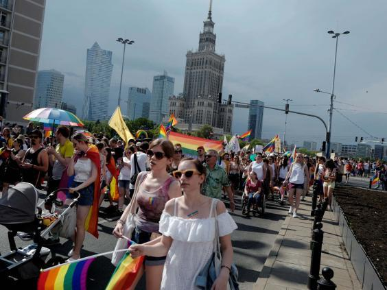 Participants take part at the 'Equality Parade' rally in support of the LGBT+ community in Warsaw (REUTERS)