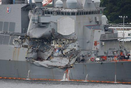 FILE PHOTO : The Arleigh Burke-class guided-missile destroyer USS Fitzgerald, damaged by colliding with a Philippine-flagged merchant vessel, is seen at the U.S. naval base in Yokosuka,, Japan June 18, 2017. REUTERS/Toru Hanai/File Photo