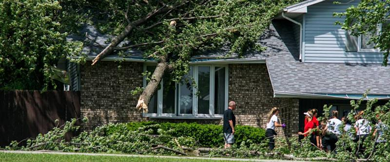 Ft Dodge Iowa United States-5/17/2017 Tree that fell on a house in Fort Dodge Iowa after a big storm