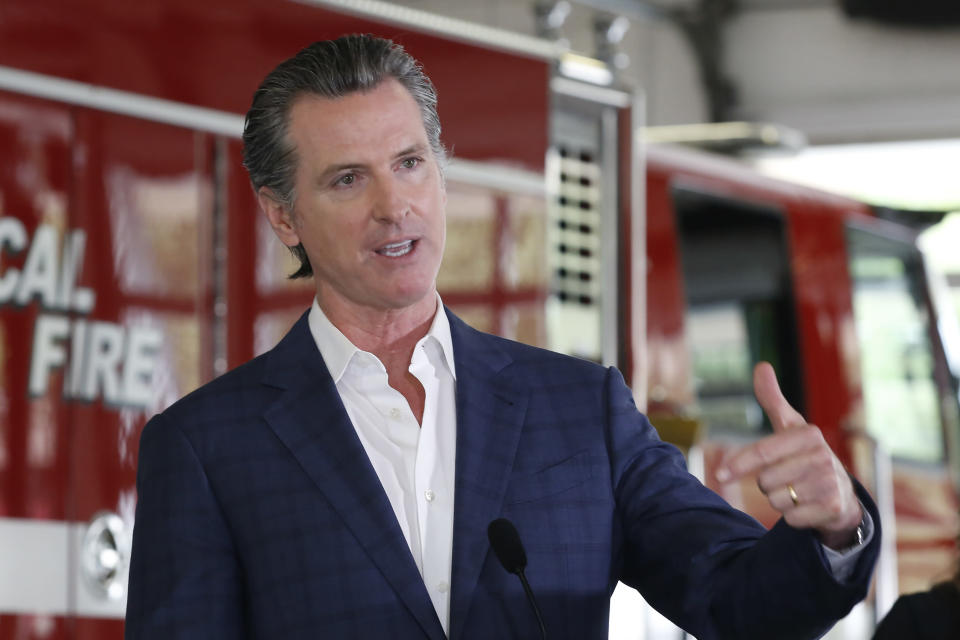 FILE - In this May 13, 2020 file photo, Gov. Gavin Newsom discusses his revised state budget proposal during a news conference at the CalFire/Cameron Park Fire Station in Cameron Park, Calif. Many state and local governments across the country have suspended public records requirements amid the coronavirus pandemic. Newsom declined for a while to release details of a nearly $1 billion contract to buy protective masks from a Chinese company. And numerous California municipalities have stopped or slowed their fulfillment of open-records requests.(AP Photo/Rich Pedroncelli, Pool)