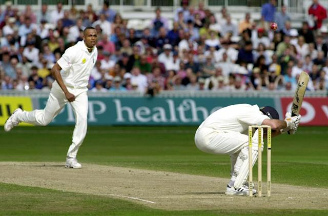 <p>Fearsome sight: Courtney Walsh puts the frighteners on Graeme Hick in 2000<br></p>