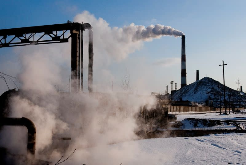 FILE PHOTO: Smokes billows from the Karabashmed copper smelter in the Urals town of Karabash